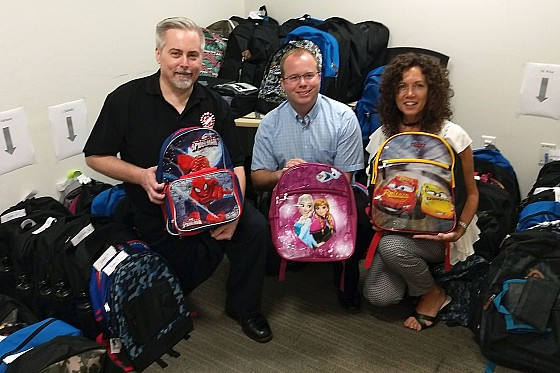 The Kinsmen Club of St. Thomas donated backpacks and back-to-school supplies to Family and Children's Services, September 2017
